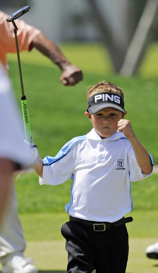 Kyle Lograsso, 7, helped Angela Stanford make the cut at the Kraft. (File photo)