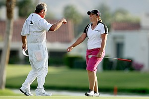 "Karen Stupples shares a laugh at No. 18 with her caddie Jerry ""Woody"" Woodard during the third round."