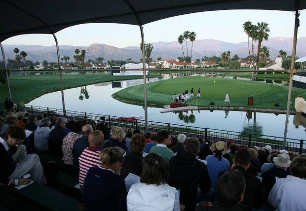 Spectators, fans and players gather at the 18th green for Easter Sunday Service prior to the final round of the Kraft Nabisco Championship.