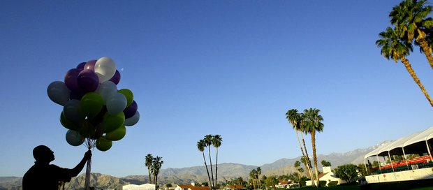 An usher with The Rock Church of Palm Desert, Diego Lyles, releases balloons during Easter Sunday Service.
