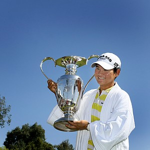Yani Tseng holds the trophy after winning the Kraft Nabisco Championship.