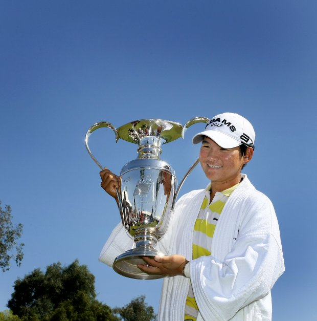 Yani Tseng holds the trophy after winning the Kraft Nabisco Championship.