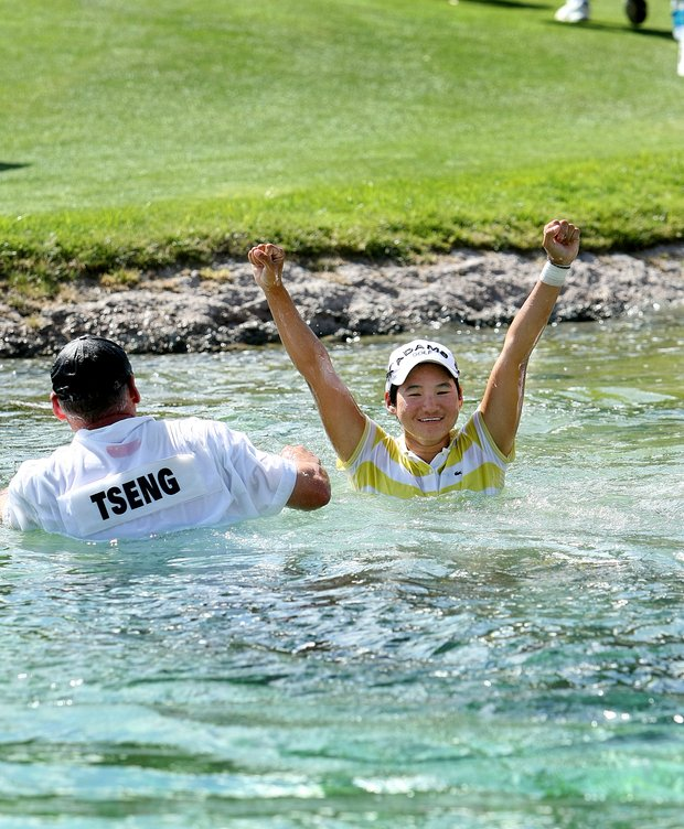 Yani Tseng celebrates in Poppie's Pond after winning the Kraft Nabisco Championship.