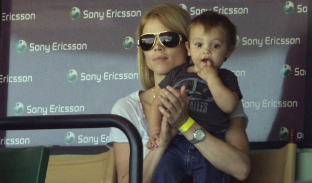 Elin Nordegren, the ex-wife of Tiger Woods, sits with her son Charlie during a semifinal match between Rafael Nadal and Andy Roddick at the Sony Ericsson Open on Friday, April 2.