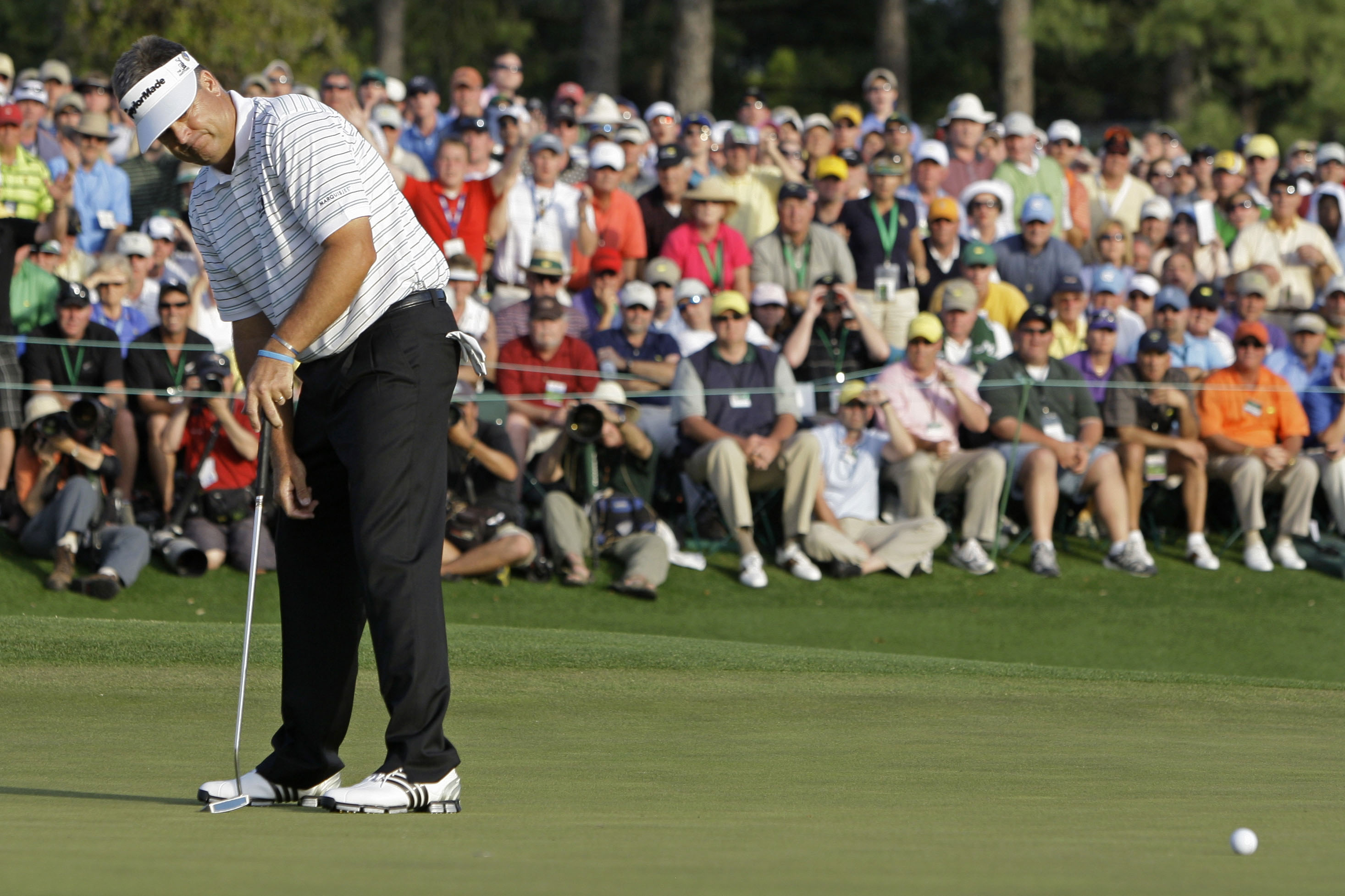 Kenny Perry watches as his par putt on the 18th hole misses during the final round of the 2009 Masters.