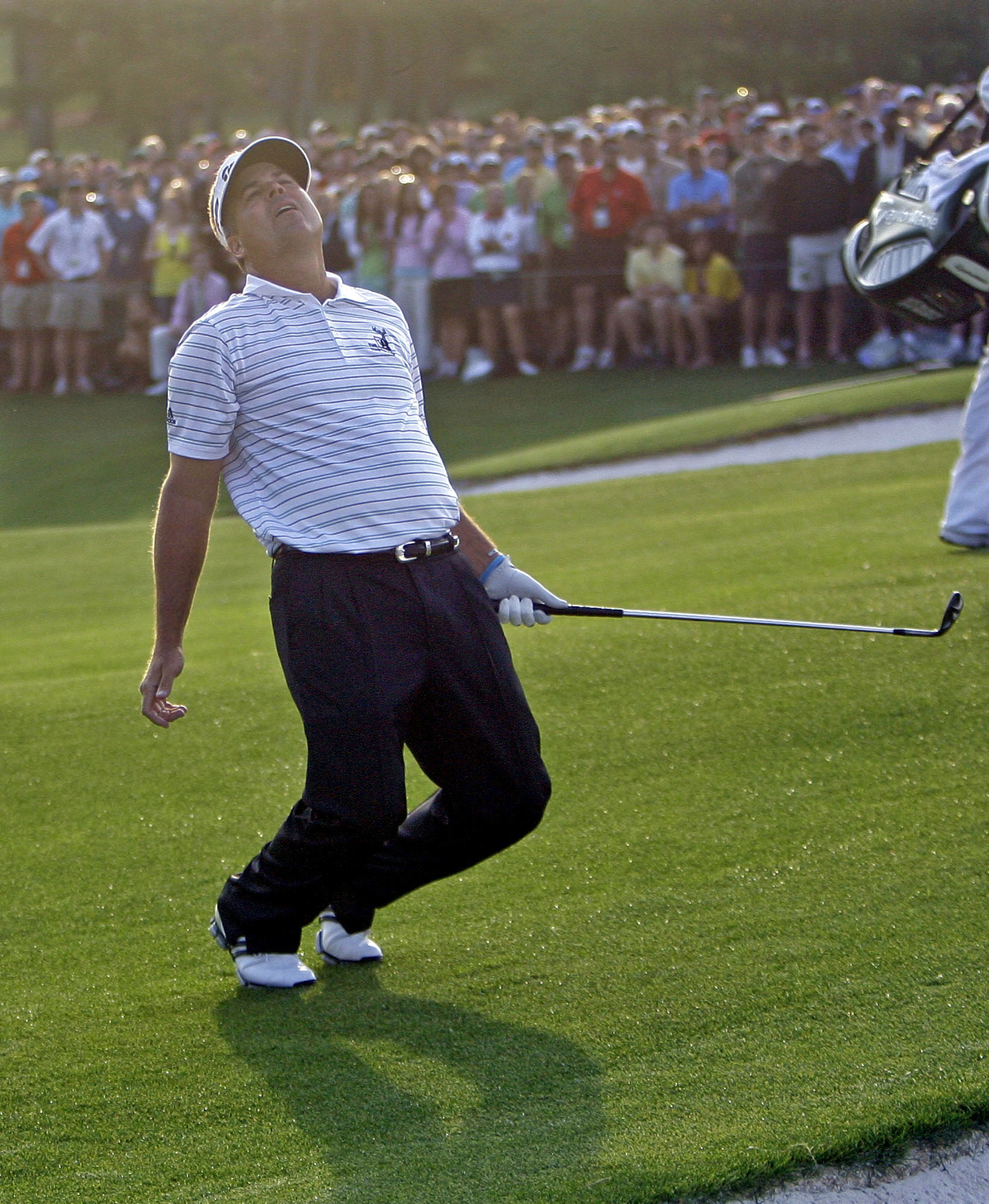 Kenny Perry reacts after his chip shot to the 18th hole missed the cup during the first hole of sudden playoff at the 2009 Masters.