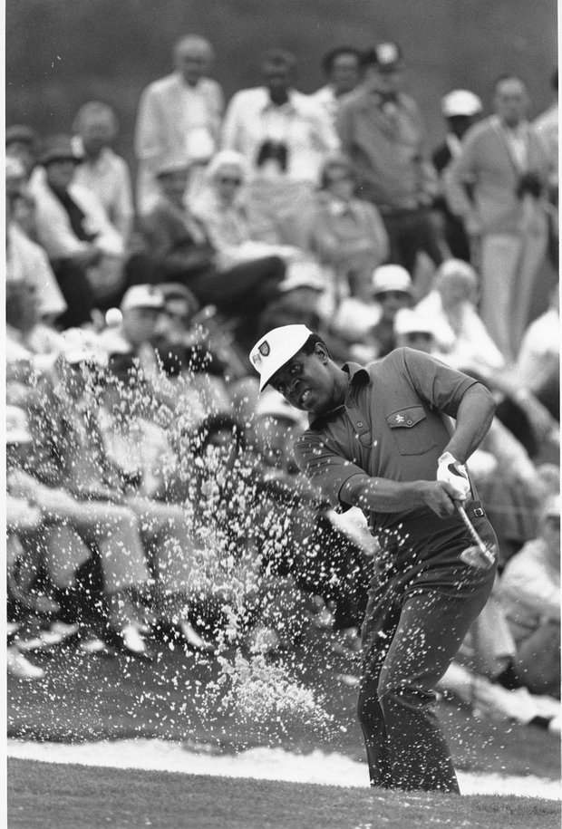 Lee Elder hits the ball from a bunker on the 18th hole at the 1975 Masters.