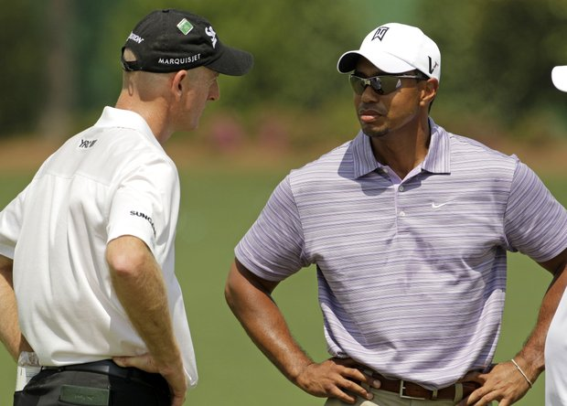 Tiger Woods chats with Jim Furyk at the Augusta National on Sunday.