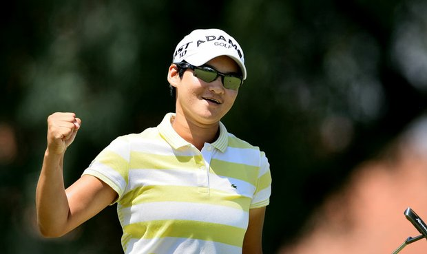 Yani Tseng pumps her fist after dropping a birdie putt at No. 8 during the final round of the Kraft Nabisco Championship.