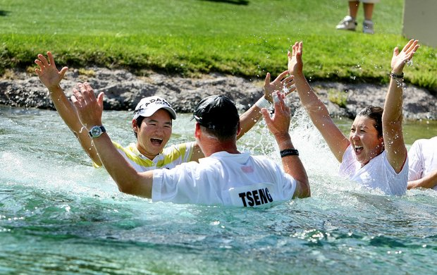 Yani Tseng celebrates after jumping into Poppie's Pond with her caddie, friends and family.