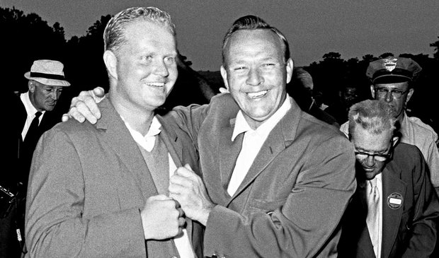 Arnold Palmer (right) laughs with Jack Nicklaus while adjusting Nicklaus' second green jacket at the 1965 Masters Tournament.
