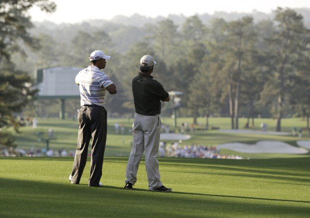 Tiger Woods (left) stands alongside Fred Couples during a Monday morning practice round at Augusta National.