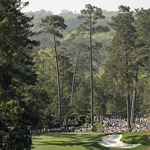 Tiger Woods and caddie Steve Williams walk down Augusta National's 10th hole during a practice round Monday.