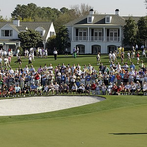 Tiger Woods strokes a putt on the ninth hole Monday at Augusta National.