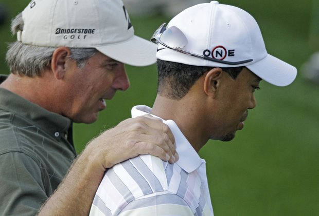Fred Couples (left) puts his arm around Tiger Woods during a practice round Monday at Augusta National.