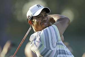Tiger Woods tees off on No. 1 at Augusta National on Monday.