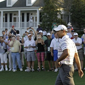 Tiger Woods acknowledges the gallery Monday during a practice round at Augusta National.