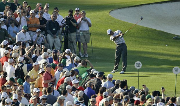 Tiger Woods hits a drive on the third hole Monday during a practice round at the Masters.