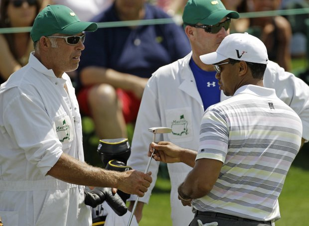 Tiger Woods and caddie Steve Williams during Monday's practice round at Augusta National.