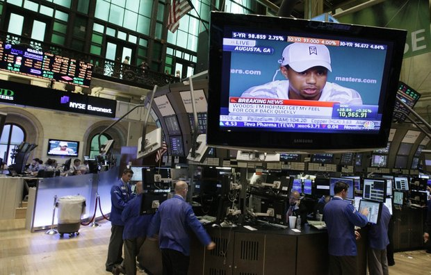 The Tiger Woods news conference is seen on television screens on the floor of the New York Stock Exchange on Monday.