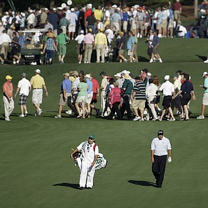 Defending Masters champion Angel Cabrera makes his way down the seventh fairway on Tuesday.