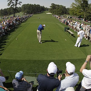 Ernie Els hits a tee shot at No. 8 Tuesday at Augusta.