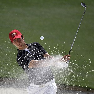 British Amateur champion Matteo Manassero hits out of a bunker at the 18th during Tuesday's Masters practice round.