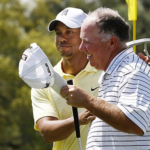 Tiger Woods and Mark O'Meara walk off the 18th green Tuesday after playing a practice round together.