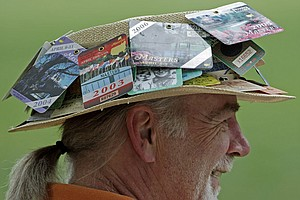 Richard Van Frank, from Portland, Ore., sports a nifty hat while watching the first round at Augusta National.