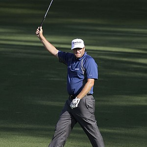 Steve Marino celebrates after pitching in for an eagle on No. 2 during the first round.
