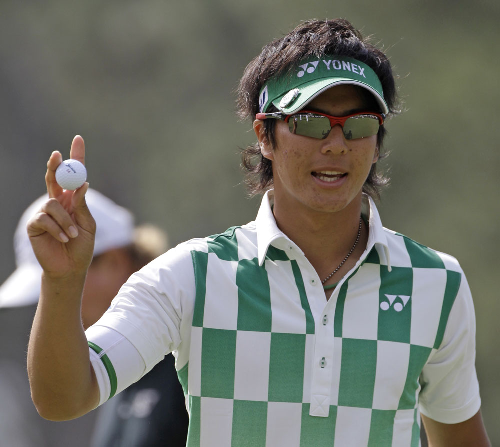 Ryo Ishikawa waves to the crowd after making birdie on No. 1.