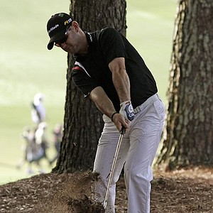 Rory Sabbatini hits out of the pine straw off the first fairway.