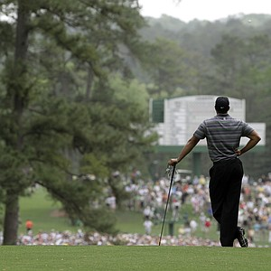 Tiger Woods waits to play at the par-5 second hole Thursday.