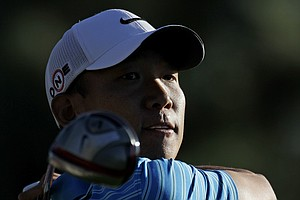 Anthony Kim follows a shot during the second round of the Masters. Kim hold a share of third entering weekend play.
