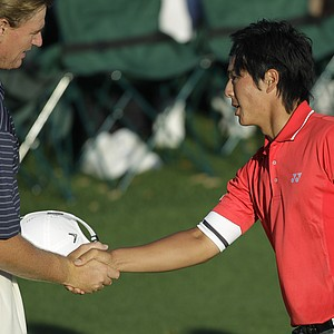 Ernie Els and Ryo Ishikawa shake hands after Round 2.
