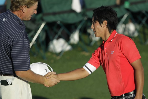 Ernie Els and Ryo Ishikawa shake hands after Round 2.