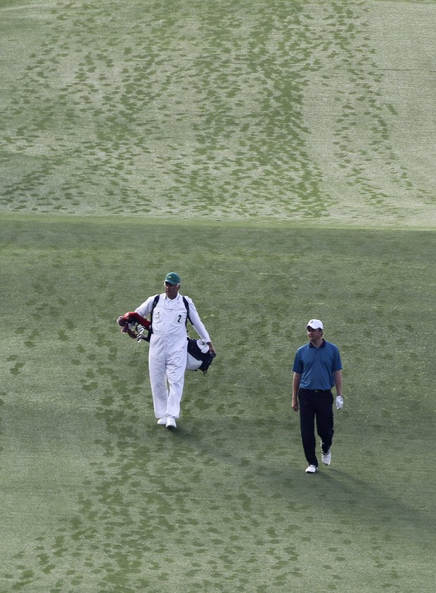 Nathan Smith (right) and his father, Larry, walk down the first fairway during the first round of the Masters.