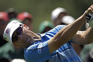 Ricky Barnes tees off at the eighth hole during the second round of the Masters.