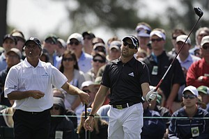 Fred Couples, left, watches as Sergio Garcia reacts to his tee shot at No. 8.