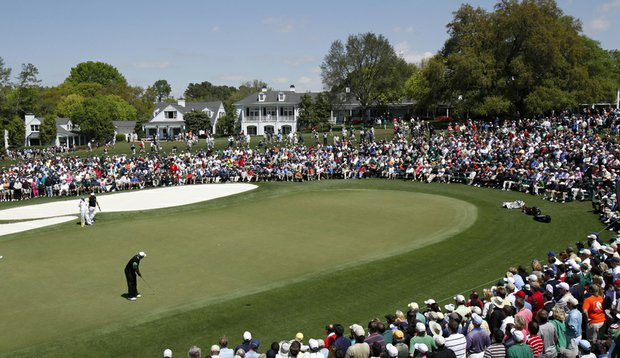 Tiger Woods stands over a putt at the ninth green.