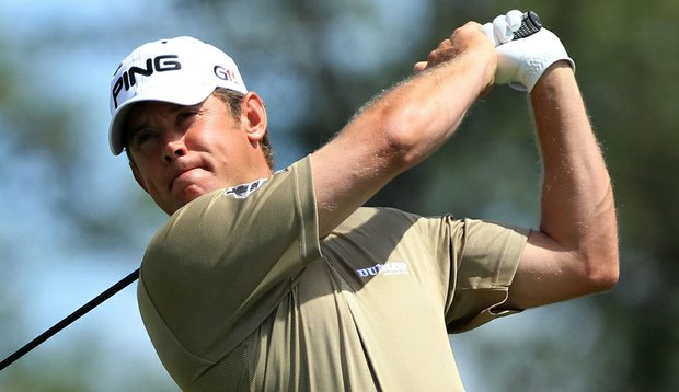 Lee Westwood plays his tee shot on the first hole during the third round of the Masters.