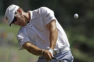 Ricky Barnes plays an approach shot during the third round of the Masters.