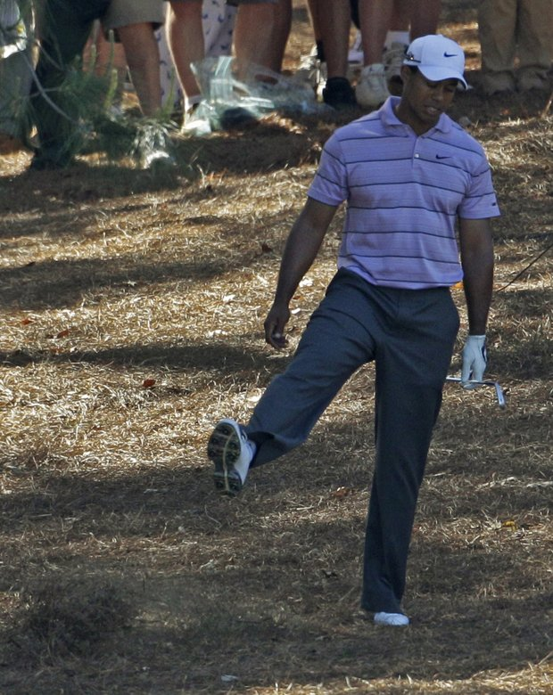 Tiger Woods after playing his second shot at No. 9.
