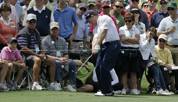 Tom Watson hits from the second fairway Saturday at the Masters.