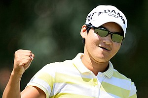 Yani Tseng pumps a fist at the eighth hole during the final round of the Kraft Nabisco Championship.