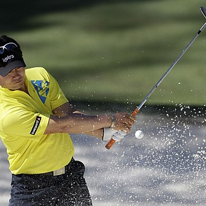 Y.E. Yang hits out of the sand at Augusta's 10th.