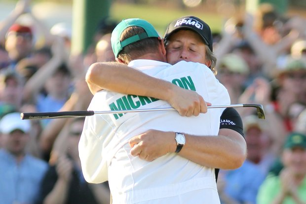 Phil Mickelson hugs his caddie Jim Mackay after his three-stroke victory at the 2010 Masters.