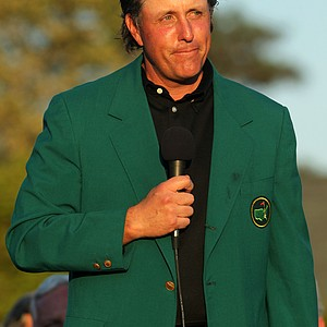 Phil Mickelson speaks to the gallery during the green jacket presentation.