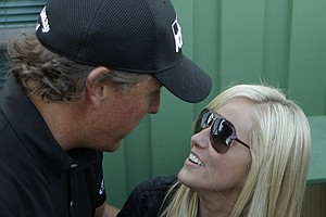 Phil Mickelson talks to his wife Amy after winning the Masters. Amy was diagnosed with breast cancer in May 2009.