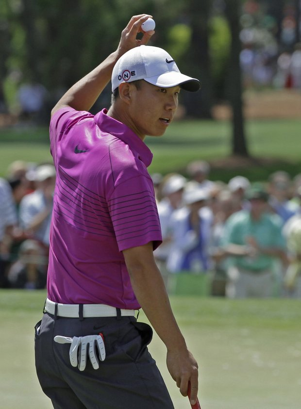 Anthony Kim holds up his ball after making birdie on the second hole Sunday.